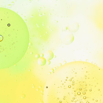 Lime lemonade background with bubbles and raindrops