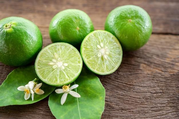 Lime sliced ,green leaf on wooden table