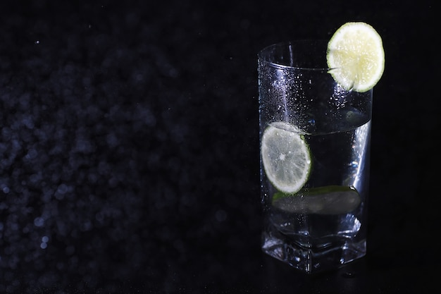 Lime water. drinking water with fresh lime. mineral water. healthy, mineral-rich, refreshing water with lime.