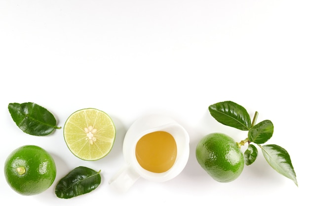Lime with half and leaf isolated on white surface. fresh fruit with leaf. set or collection. lemon juice and green lemon. flat lay. it's freshly picked from home growth organic garden. food concept