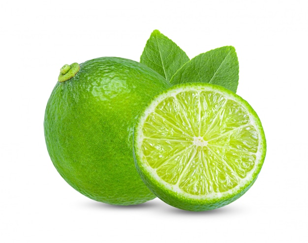 Lime with leaves on white wall
