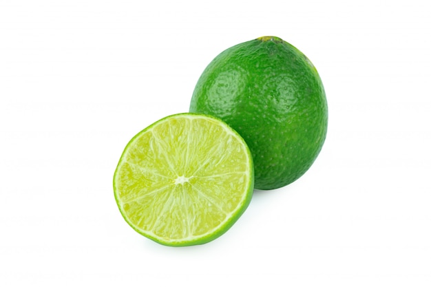 Lime with slices half on white wall