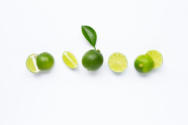 Limes with leaf isolated on white