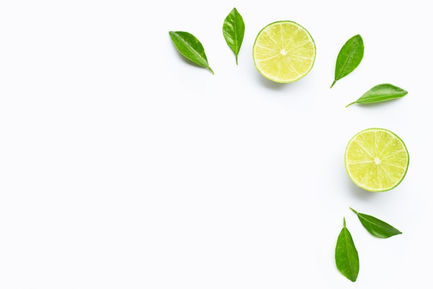 Limes with leaves isolated on white
