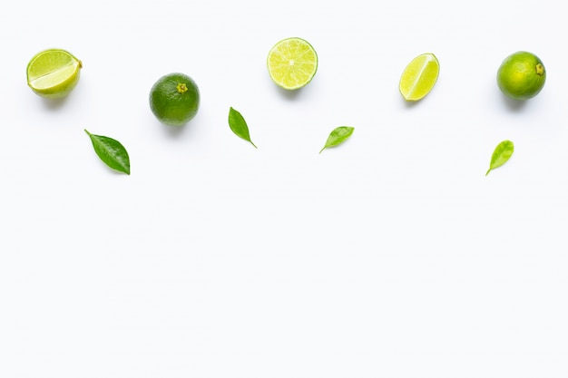 Limes with leaves isolated on white.
