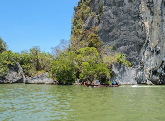 Limestone mountain with long-tailed boat in phang nga province, thailand