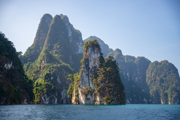 Limestone mountains with trees in the sea in thailand