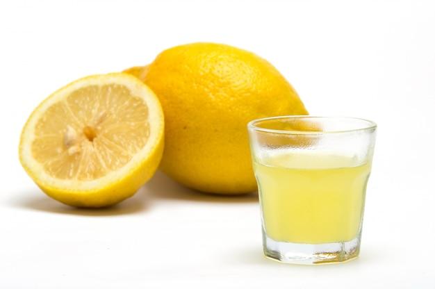 Limoncello, liqueur lemon on white