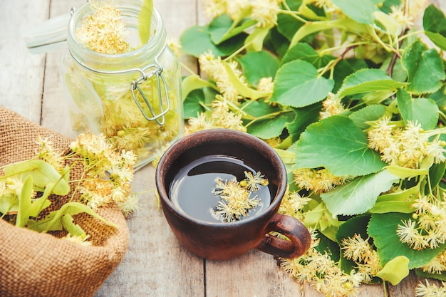 Linden tea and flowers. selective focus.