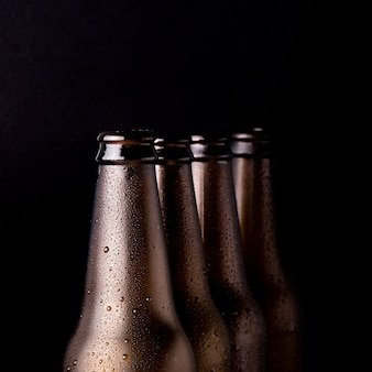 Line of black beer bottles