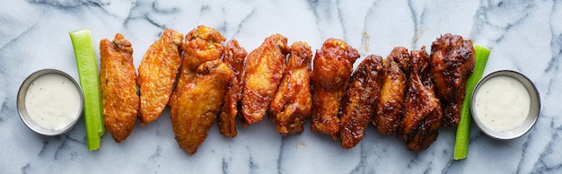 Line of buffalo wings with different flavors