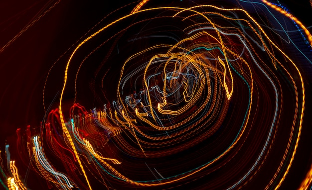 Line car headlights with long exposure. abstract background.