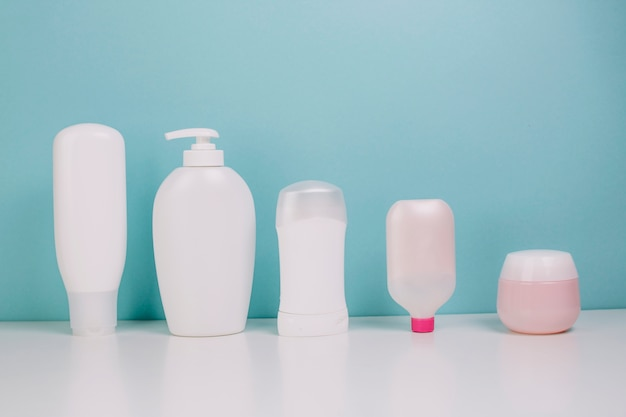 Line of cosmetics bottles and jar