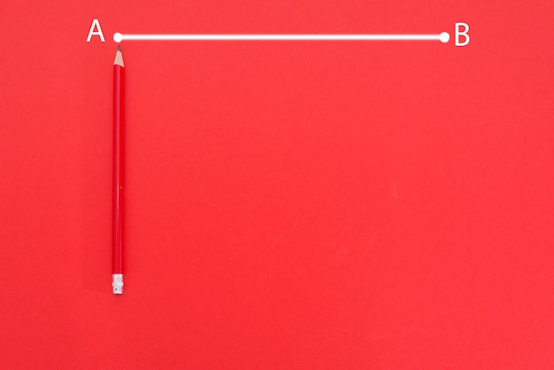 The line from point a to point b is drawn in white on a red background with red pencil and copy space.