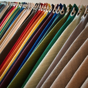 Line of hanging textured fabrics of different colors and shades