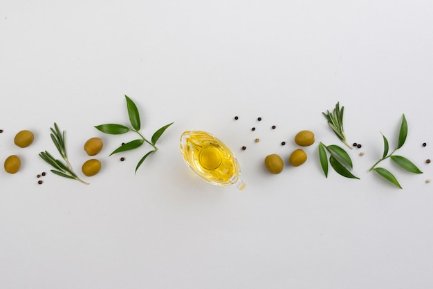 Line made of leaves and olives with oil cup