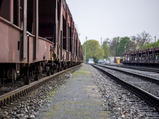 Line of old train carriages on a railway