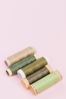 Line of reels of green yarn
