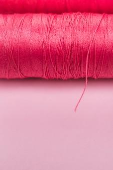Line of reels of warm colors yarn
