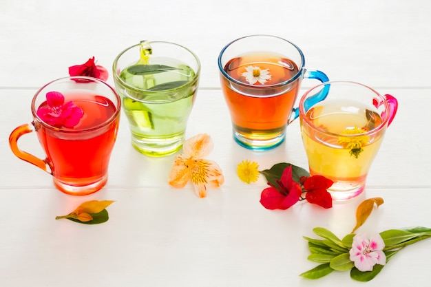 Line of tea glasses with flowers