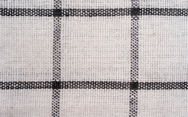 Lined black and white dinner clothes pattern, close up of white and black checkered towel textured