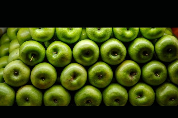 Lined green apples on a counter.