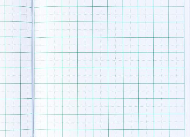 ノートブックの背景から罫線入り用紙をクローズアップ