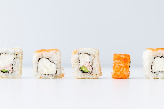 Lined up sushi rolls