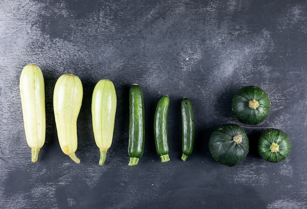 Lined up zucchinis. flat lay.