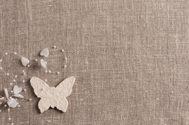 Linen background with white butterfly, copysàce