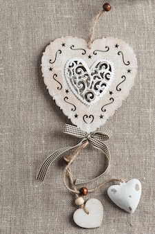 Linen background with xmas hearts