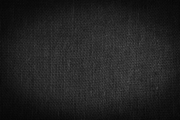 Предпосылка текстуры льняной ткани. черно-белый фон. каркас из мятой льняной ткани.
