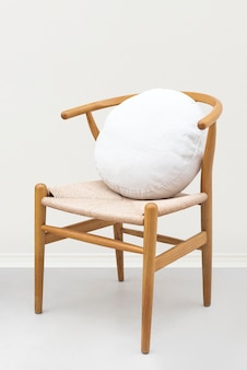 Linen cushion cover in white on a chair
