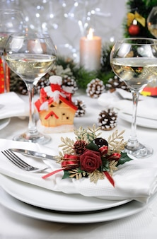 Linen napkin, decorated with christmas corsage  on the table