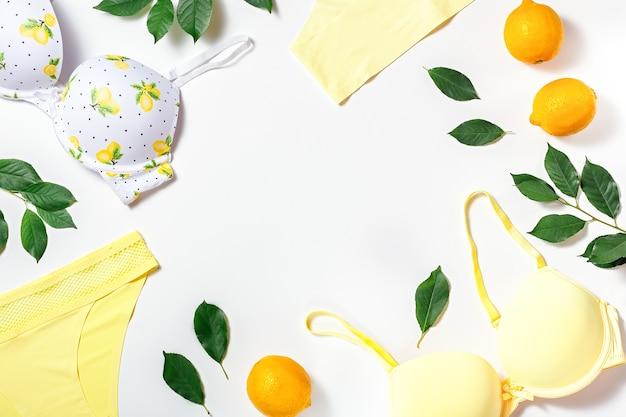 Белье с лимонами на белом, копией пространства