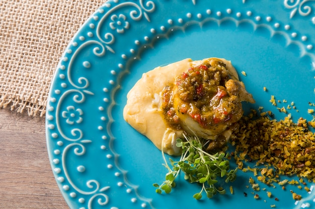 Linguado fish with mashed banana from the ground and farofa,