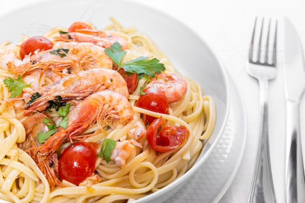 Linguine with shrimps and cherry tomatoes.