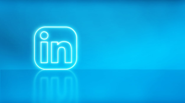 Linkedin logo in neon with space for text and graphics. blue background.