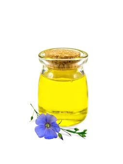 Льняное масло в стеклянной банке с синим цветком льна на белом фоне