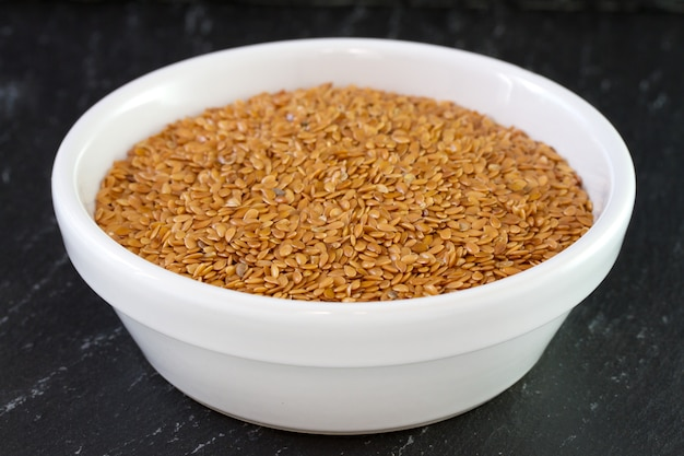Linseeds in white bowl