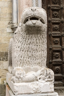 Lion statue in front of parma cathedral, italy. statue was made by giambono da bissono