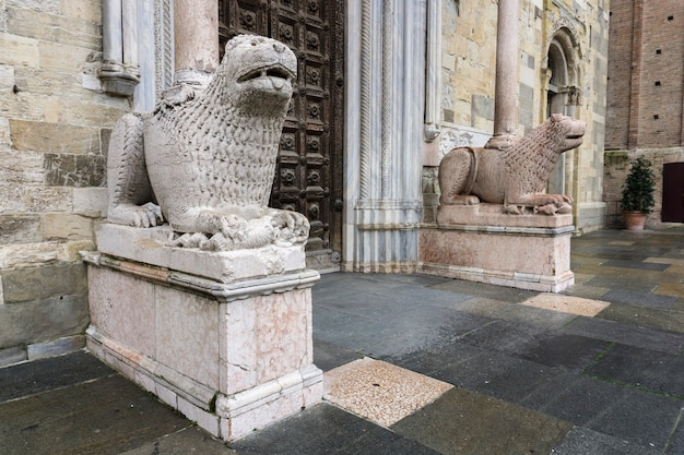 Lion statues in front of parma cathedral, italy. statues were made by giambono da bissono
