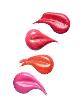 Lip gloss brush strokes in different shades isolated on white