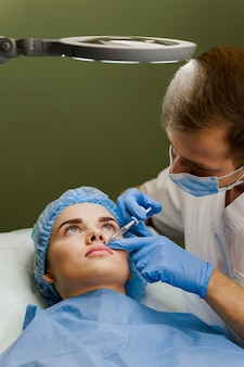 Lips augmentation injections for attractive girl