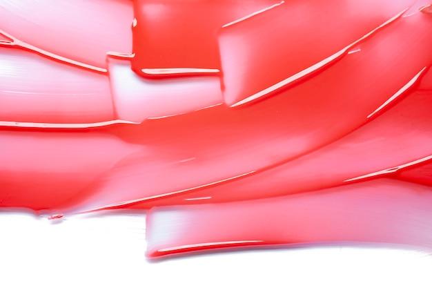 Помада абстрактный бальзам для губ мазки фон палка мазок волна красный текстура фон