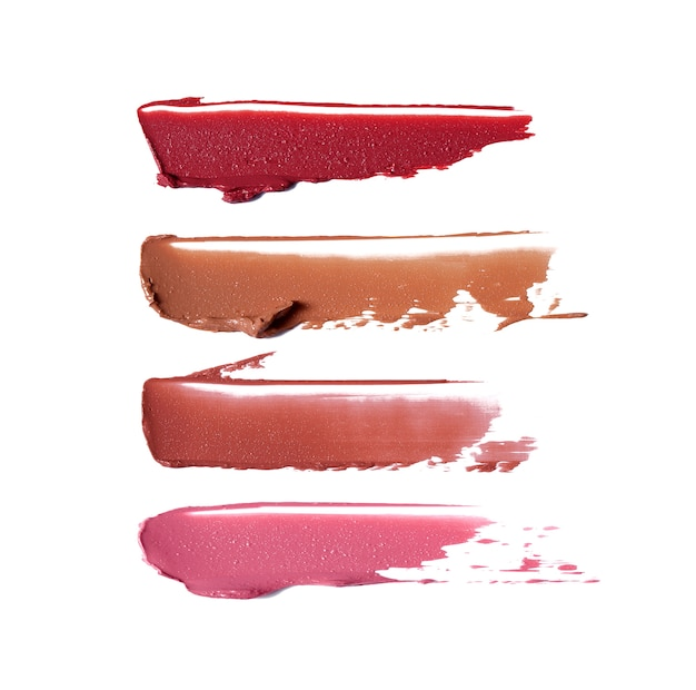 Lipstick brush strokes in different shades isolated on white
