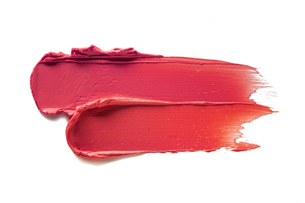 Lipstick coral peach smudge swatch on white colored background