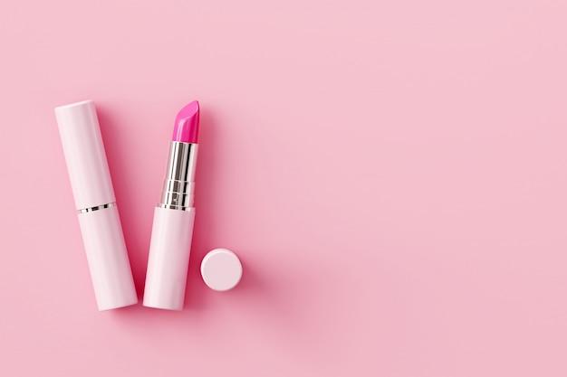 パステル調のピンクの背景に口紅。美しさの概念。