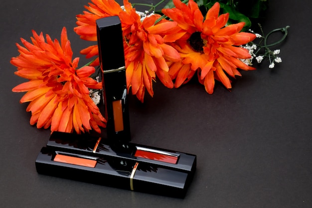Lipstick and orange flowers for women