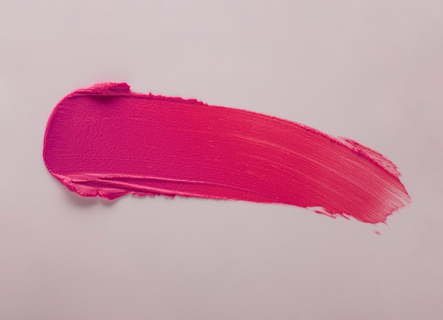 灰色の背景に口紅ピンクの汚れ見本